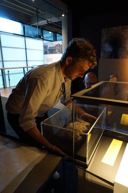 Andy Holbrook removes fatberg from its display.