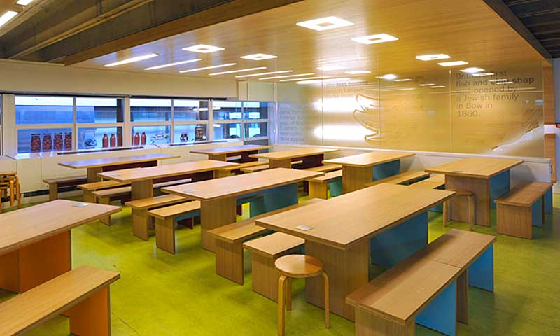 The interior upper level of the Lunch Space at the Museum of London, with bright benches for families and schools to use.