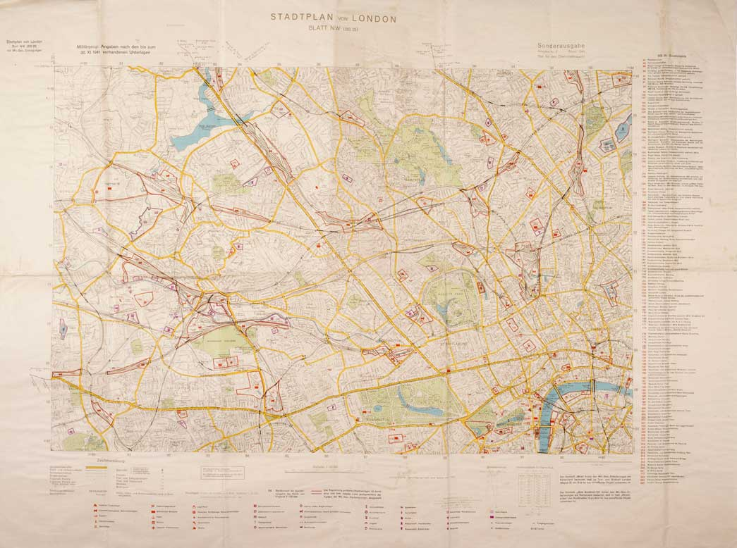 London Street Map printed for use by Luftwaffe pilots when flying bombing missions over London. Colour coded bombing targets have been printed on the map in red and purple. A key down the side identifies these targets which include Museums (including the London Museum), railway stations, Government and Royal buildings and services e.g. gasworks. The Map covers an area from Ealing in the West to Islington in the East, Hampstead in the North and Westminster in the South.
