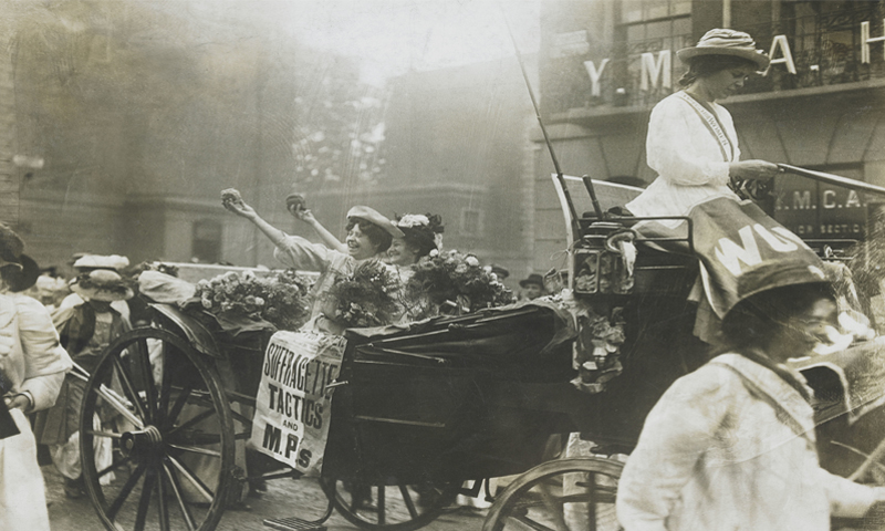 Suffragettes handing things out