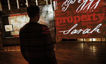 A visitor looks at a display in the London, Sugar & Slavery gallery