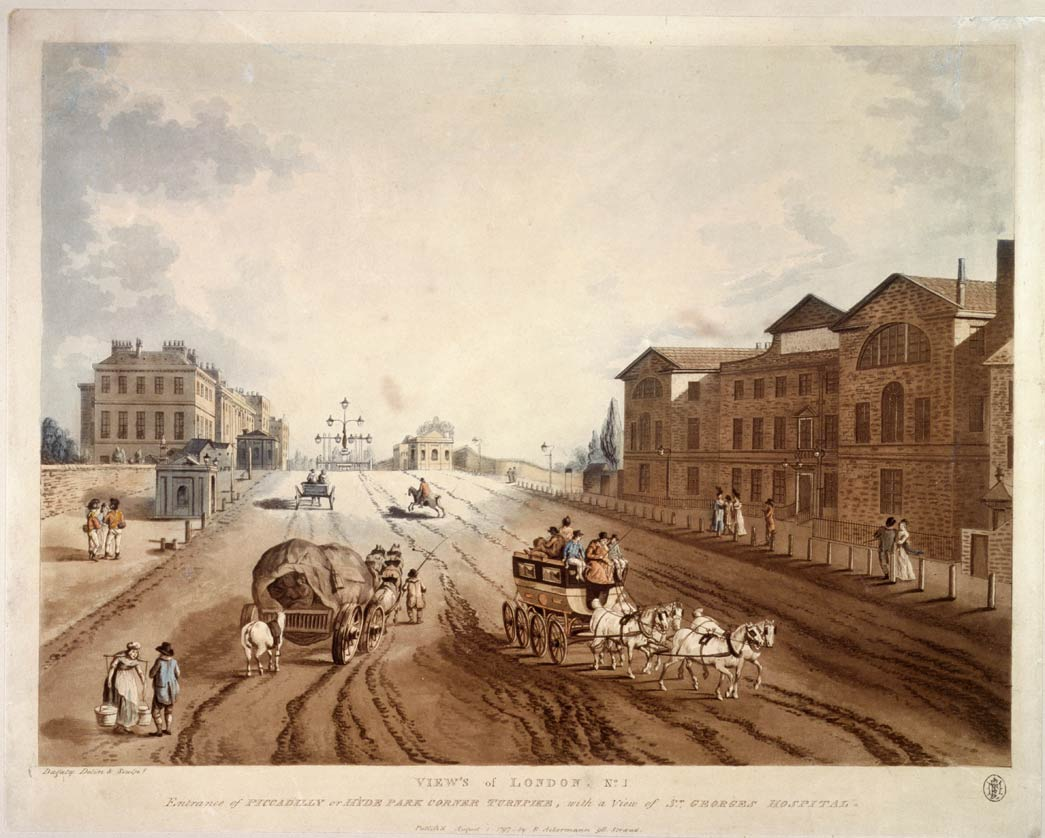 Coloured aquatint with engraving. Street scene showing wagons and a carriage on a very muddy road. Houses in Piccadilly are on the left and the hospital on the right. The turnpike gates can be seen in the middle distance.