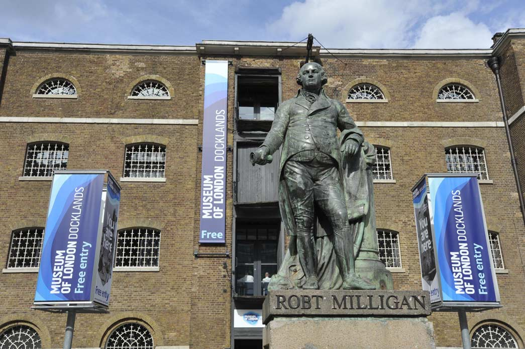 The entrance to the Museum of London Docklands, and statue of slaveholder Robert Milligan.