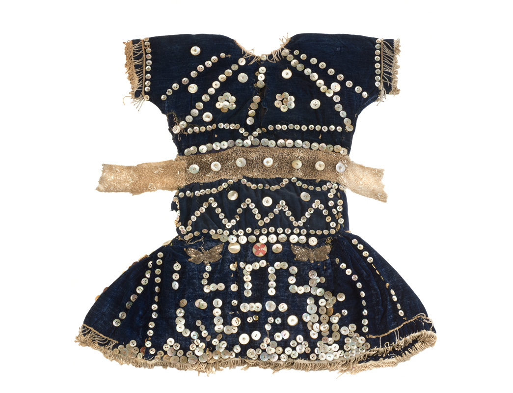 Pearly dress for a child, with Little Queenie written on in sequins.