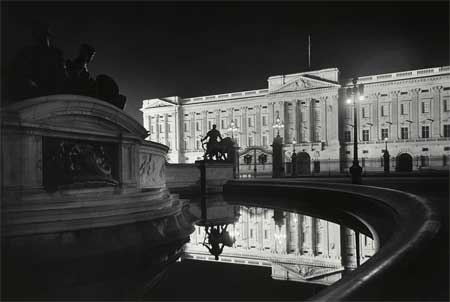 Floodlit Buckingham Palace from the north east, c. 1930.