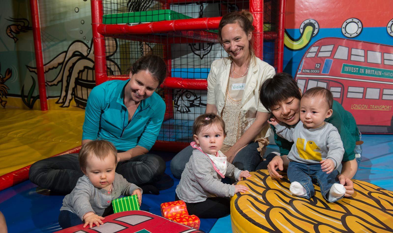 Children and their parents enjoy the soft play area in the Museum of London Docklands Mudlarks gallery.