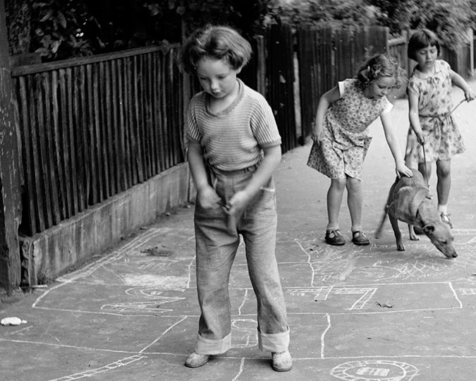 Girls playing hopscotch in the street, Henry Grant, c. 1955. ID number HG1609/45 Associated image
