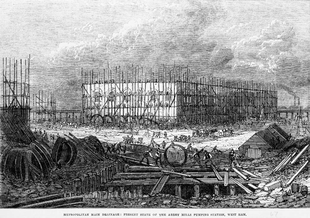 'Metropolitan main drainage: present state of the Abbey Mills pumping station, West Ham.' Exterior view of construction work on drainage and sewers. From the Illustrated London News.