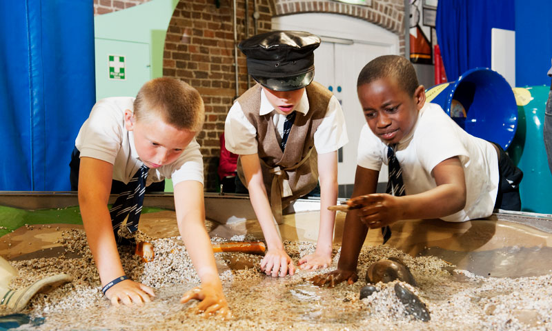 Children getting hands-on in Mudlarks gallery during an SEN session at the Museum of London Docklands.
