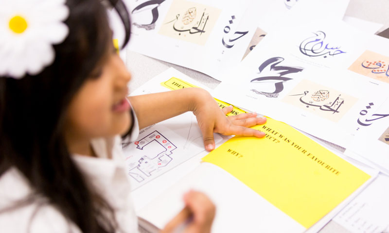A young student creates a museum-inspired artwork during a Museum of London supplementary school session.