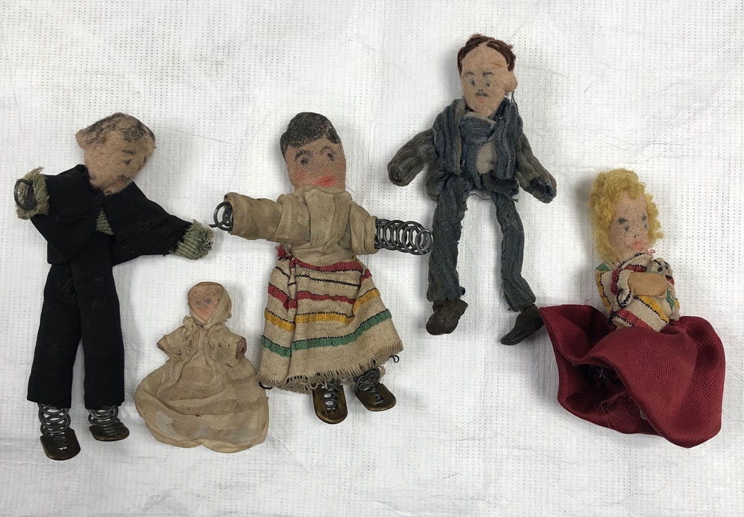These rag dolls were made for Alba Nisbet by her parents during the Second World War. While it was not unusual for parents at this time to have made rather than purchased toys for their children, these dolls were constructed using some surprising materials.