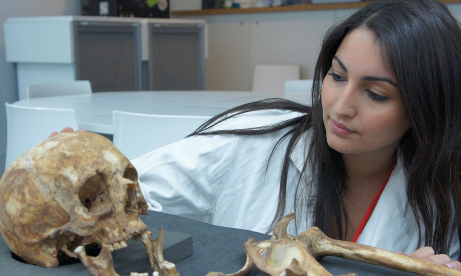 A student researches human remains at the Museum of London during a research placement.