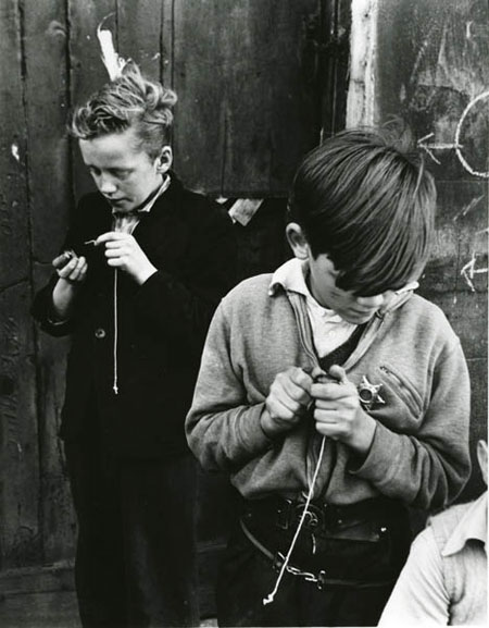 Two boys playing conkers in Addison Place, Notting Hill Roger Mayne, 1957