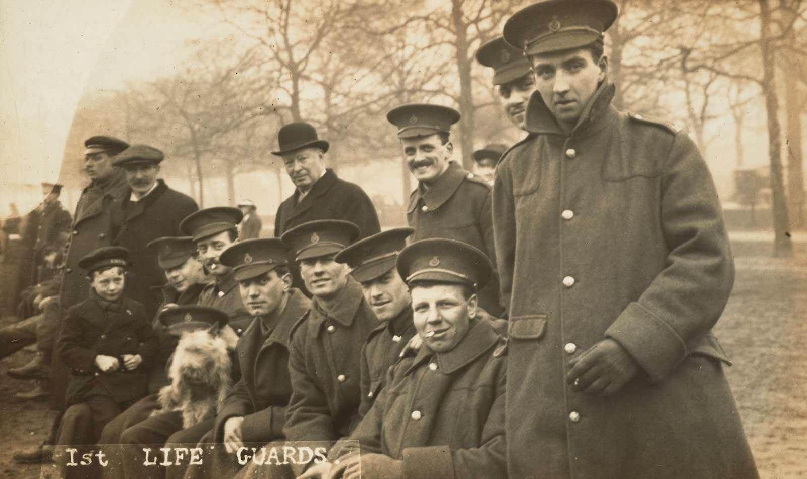 Group of Life Guards watching a football match. Photograph by Christina Broom, 1914-1915