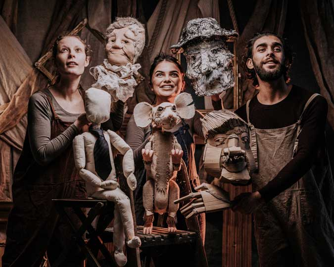 Three members of Moth Physical Theatre hold the puppets created for Meet the Real EastEnders