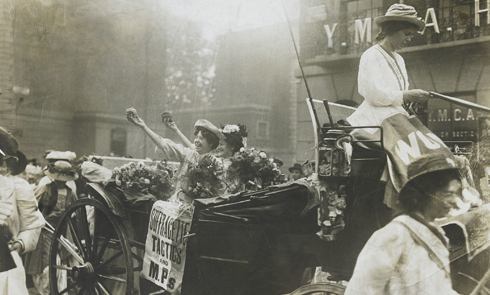 Suffragettes giving things out