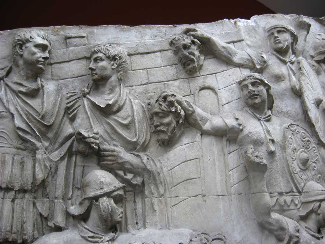 Showing scenes of headhunting by the Roman military.