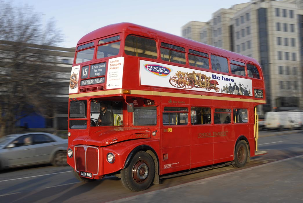 Routemaster bus with a Museum of London Advertisement on the side of it.