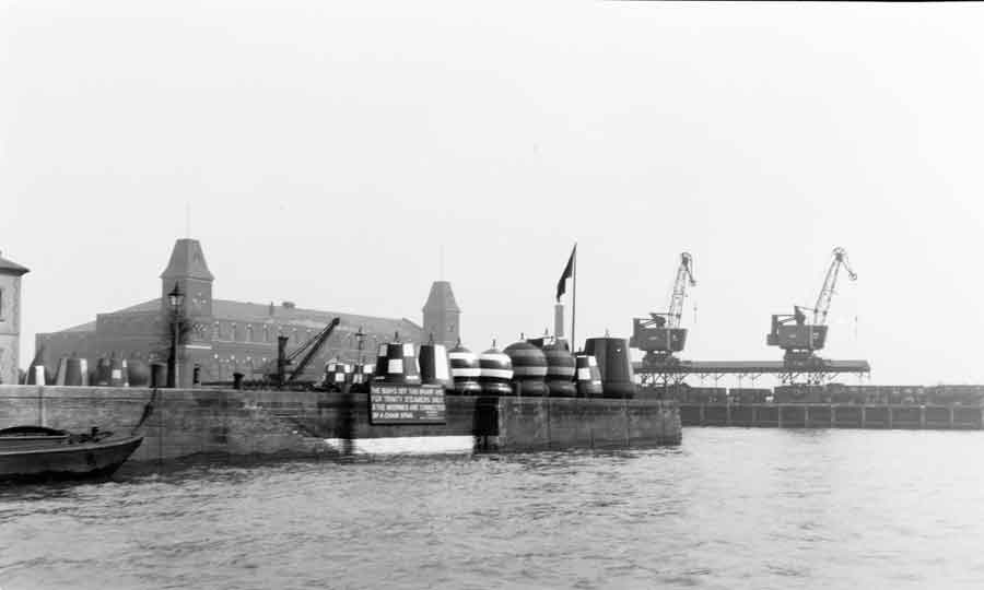 Buoys lined up along a quayside in 1948 © PLA Collection.