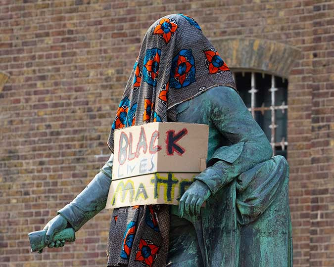 Robert Milligan statue with protest placard and cloth June 2020 © David Parry