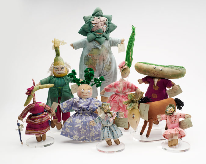 Group shot of 9 of Una Maw's cloth vegetable dolls.