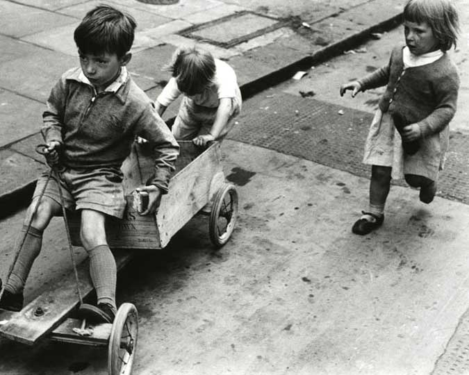 children playing with a homemade go-kart