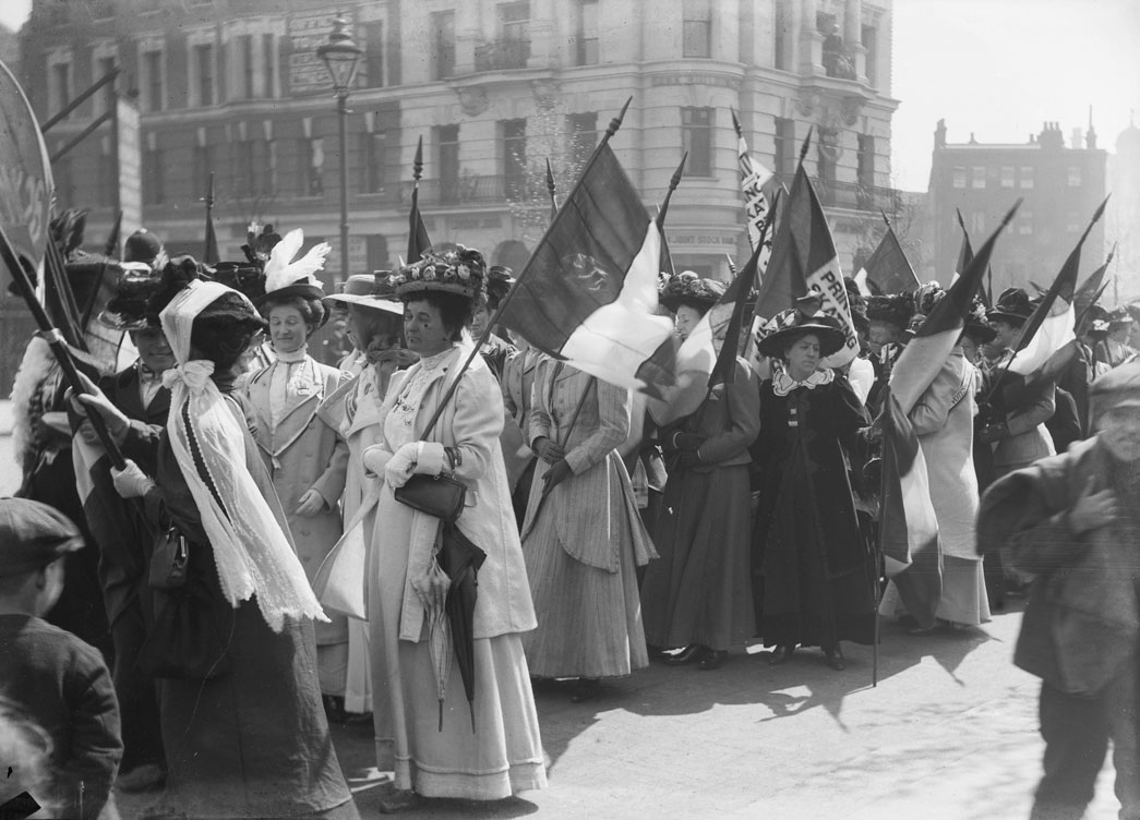 Suffragettes prepare to march in a procession to promote the Women's Exhibition, May 1909.