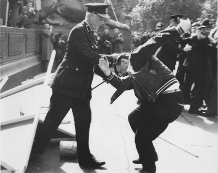 This image shows clashes at a Mosley riot in Trafalgar Square between supporters, protestors and the police, c. 1960. Sir Oswald Mosley was a leader of the British fascist movement. A prominent figure before the Second World War, he stood at the 1959 general election for Kensington North, shortly after the 1958 Notting Hill race riots, and again at the 1966 general election, this time for Shoreditch and Finsbury. However, opposition to fascism was strong in post-war Britain and on both occasions he polled few votes.