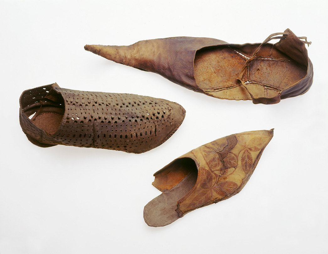 Several leather medieval shoes, some with long pointed toes.