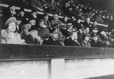 League South Cup Final, Chelsea vs. Millwall at Wembley. Spectators include King George VI, Queen Elizabeth and Princess Elizabeth, 7 April 1945 © Wembley Press Office