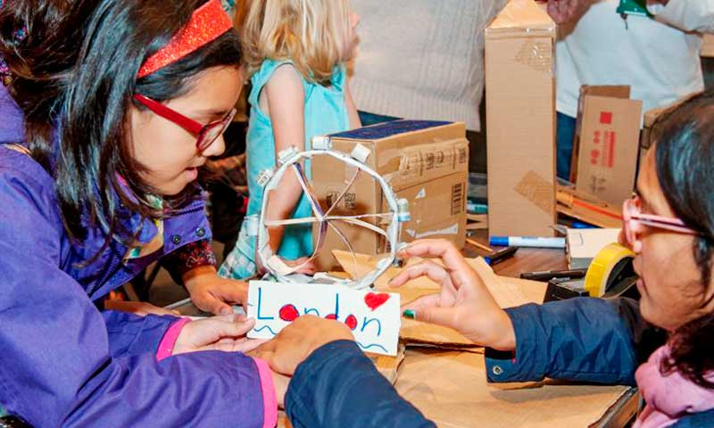 A mother and daughter creating a London landmark in cardboard during a museum families session.