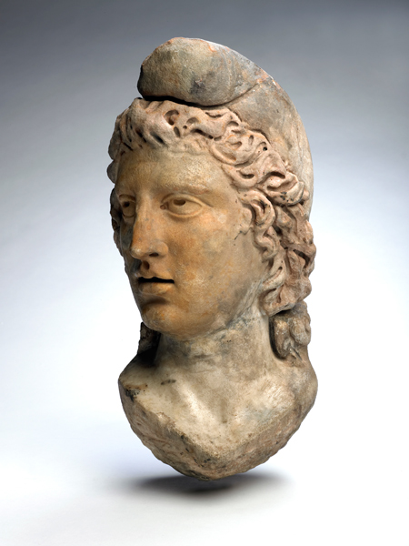 Statue head of God Mithras. This statue head was found buried in the Mithraeum floor at Bucklersbury House, Walbrook in 1954.