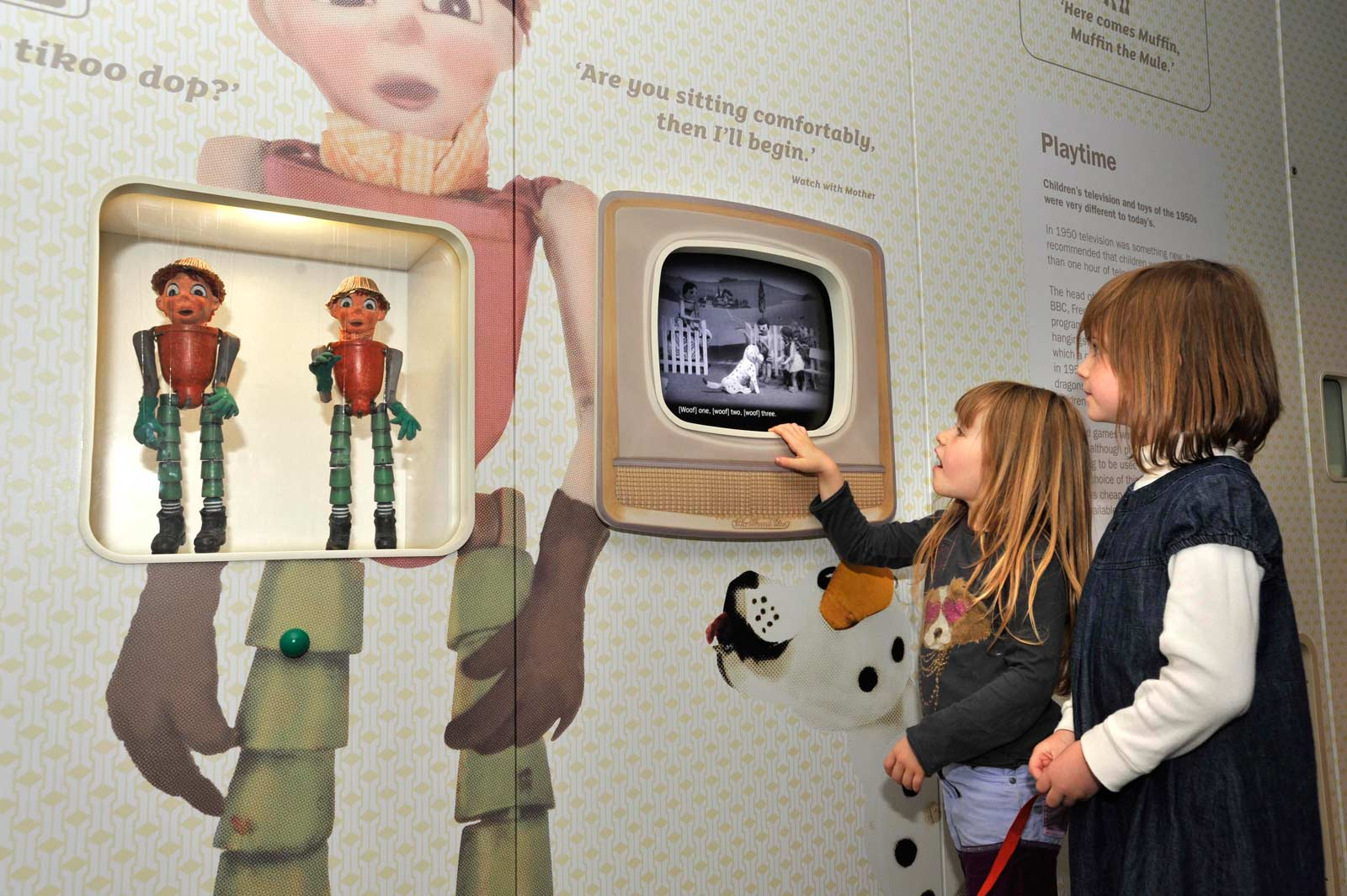 Children look at the Bill and Ben Flowerpot Men puppets on display in the World City gallery.