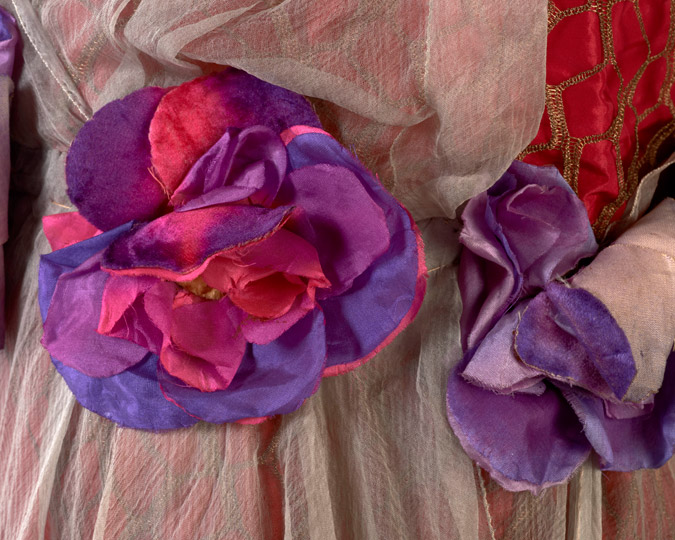 Detail of silk flowers on a dress donated by Beatrice de Cardi.