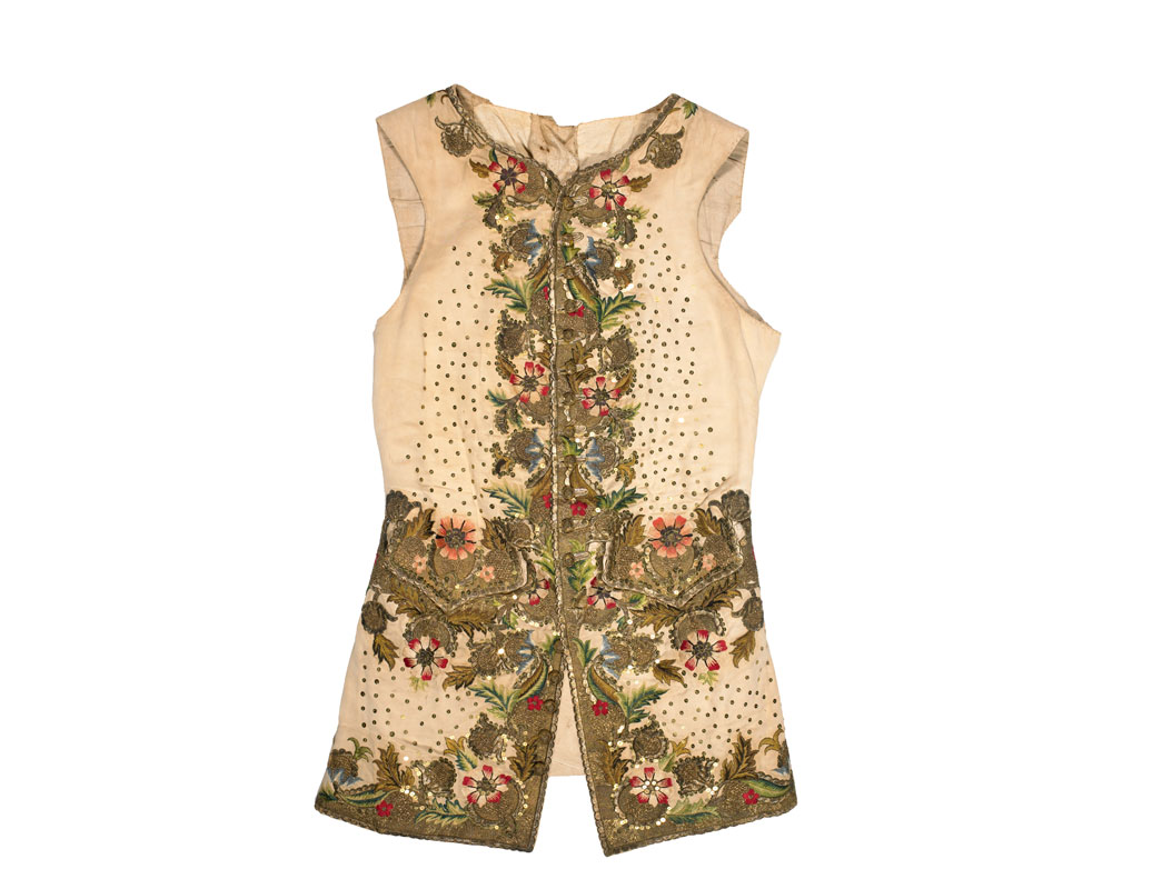 This waistcoat is decorated with a fashionable flower pattern embroidered in coloured silks and gold and silver thread. The 18th century book 'Plain Reasons for the Growth of Sodomy in England' attributed a supposed increase in homosexuality to men's dress. The author claimed that garments like this waistcoat were effeminate.