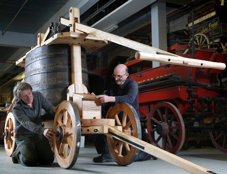 Crofords Coachbuilders assemble the fire engine at Mortimer Wheeler House.