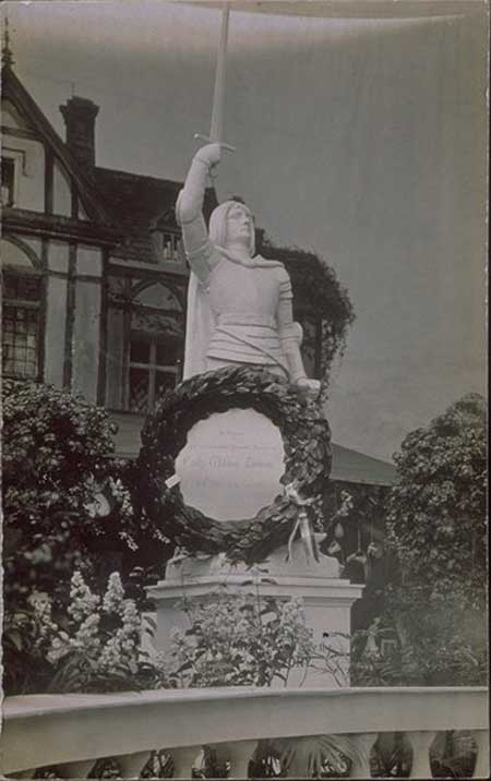 Postcard with photograph of a statue of Joan of Arc with a wreath on it, with the dedication 'In Honour and in Loving and Revered Memory of Emily Wilding Davison, She Died For Women'. During the 1913 Derby Davison ran out onto the racetrack in an attempt to stop the King's horse. She received serious head injuries and died 4 days later. The WSPU organised a spectacular funeral procession in her honour.