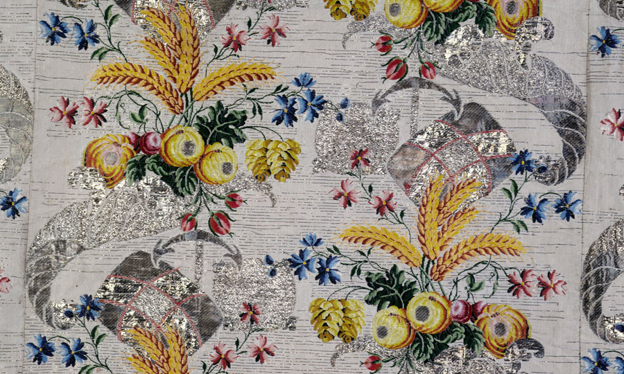 Close-up photograph showing the details of the pattern and fabric from a Court dress traditionally thought to have been worn by Mrs. Ann Fanshawe when her father, Crisp Gascoyne, was Lord Mayor of London in 1752-53. Picturechase no 001808 (c) Museum of London.