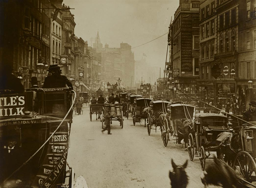 A view photographed from an omnibus on the move along High Holborn near Chancery Lane. The photograph captures a sense of the immediacy and hustle and bustle of traffic in central London at this time.