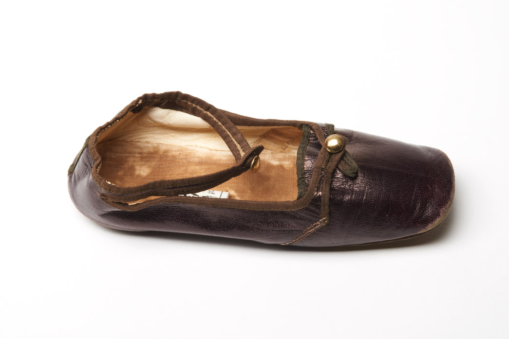 One baby shoe of bronzed kid leather worn by Prince Leopold, Duke of Albany (1853-1884), eighth child and youngest son of Queen Victoria and Prince Albert. The shoe was in the possession of Princess Alice, Countess of Athlone (1883-1981), when she died. Prince Leopold was her father.