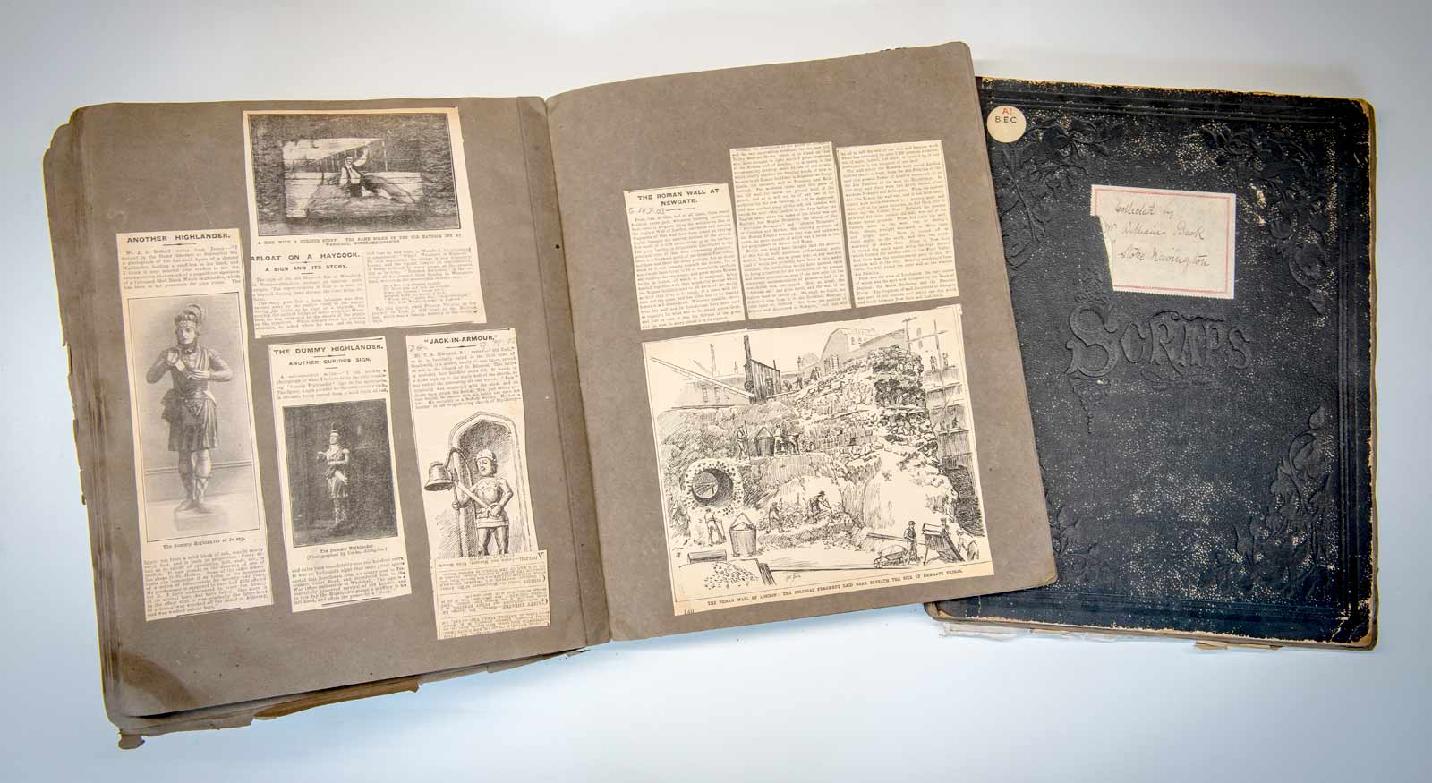 William Beck's scrapbooks; on the left, an article about the newly discovered remains of the Roman wall.