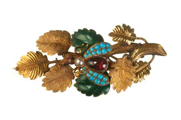 Gold brooch, chased and textured to resemble a leafy branch