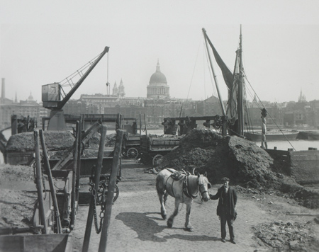 Greenmoor Wharf rubbish depot, Bankside. This Bankside wharf was the site of Southwark Corporation's rubbish depot when George Davison Reid took this photo. Refuse, transported by horse and cart, was loaded into barges using chutes and hydraulic cranes. Once laden, the barges would head downriver to the estuary. Horse manure would be separated out and used to fertilise agricultural land.