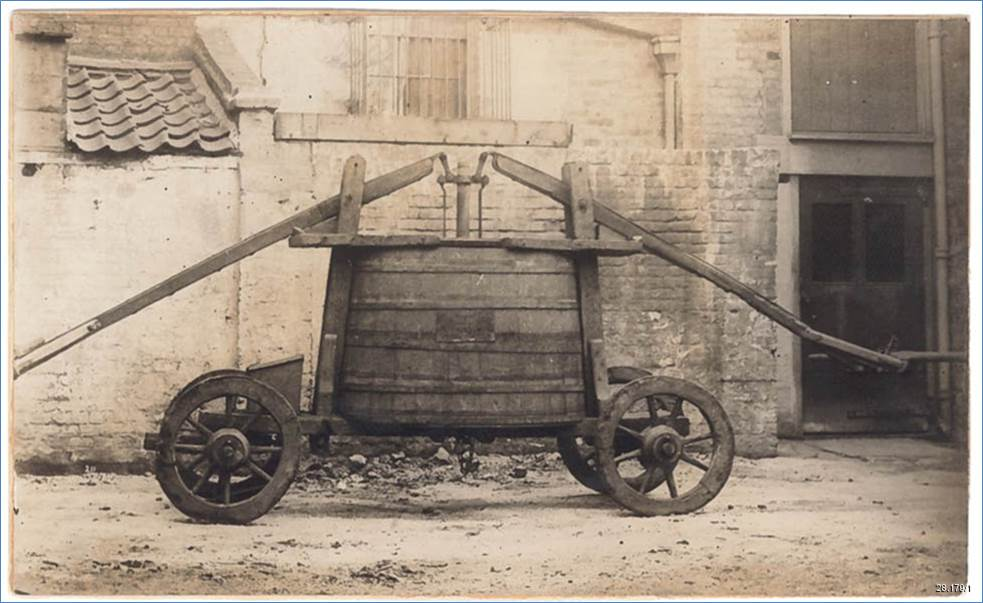 Victorian photograph showing the original 17th century fire engine in working order.
