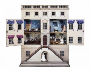 The wallpapers, fabrics and furniture of this dolls' house show the lifestyle of a wealthy family.