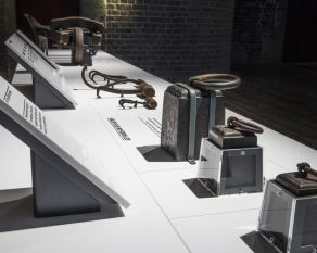 Interactive tables in the No. 1 Warehouse gallery showing weights, ropes and tools.
