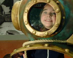 Become a diver by trying on this antique helmet in the Mudlarks gallery.