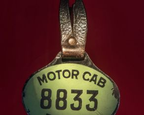 Taxi badge in the City Gallery.