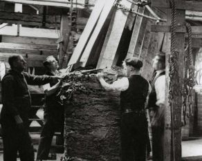 Staves of a tobacco hogshead being removed. Copyright PLA Archive/Museum of London.