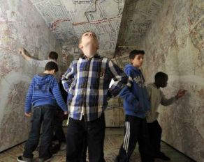 Children examine the Booth Poverty Map interactive display.